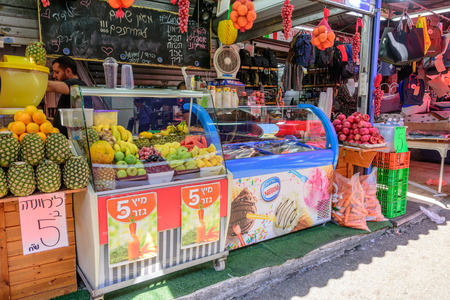 TEL AVIV - OCT. 11, 2017: Juice and ice cream stand at the busy Carmel Market in Tel Aviv, Israel on the eve of Sukkot
