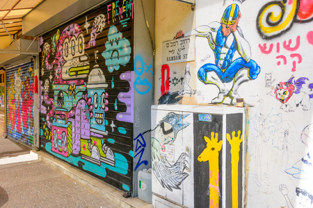 TEL AVIV - OCT 13, 2017: Modern grafitti art in the hip streets of south Tel Aviv on the pedestrian street of Nahlat Binyamin Sajtókép