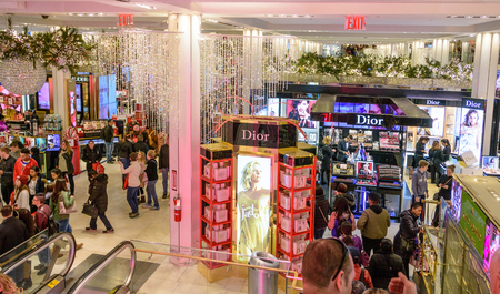 NEW YORK CITY - NOV. 25. 2017: Shoppers filling the beautifully Christmas decorated Macys Herald Square store  on Black Friday Editorial