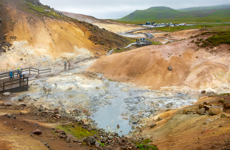 RAYKJANES, ICELAND - AUG. 3, 2018: Tourists visiting the Seltun geothermal field in the Reykjanes Penninsula near Keflavik and Reykjavik, Iceland Editorial