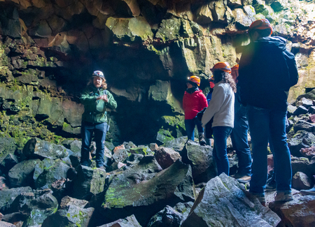REYKJAVIK, ICELAND - AUG. 2, 2018: People visiting the Raufarholshellir lava tube tunnel and caves, one of the longest in Iceland.