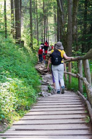GOLLINDER, AUSTRIA - JUNE 5, 2019: Family touring the beautiful Gollinder Waterfall with maxium spring flow in Upper Austria near Salzburg Editorial