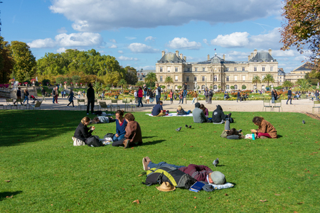 PARIS - SEPT. 24, 2018: People relaxing and enjoying the beautiful Luxemburg Gardens - Jarin du Luxembourg - in Paris, France