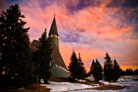 Dramatic sky over church in Slovenia