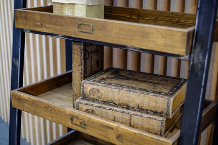 Shelves for books. Vintage books on the shelves. Zdjęcie Seryjne