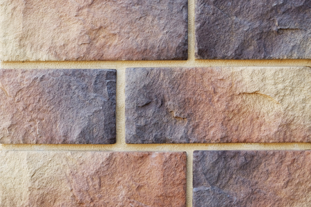 Silicate brick. Big and small. Different color. Decorative bricks. The texture of the walls.