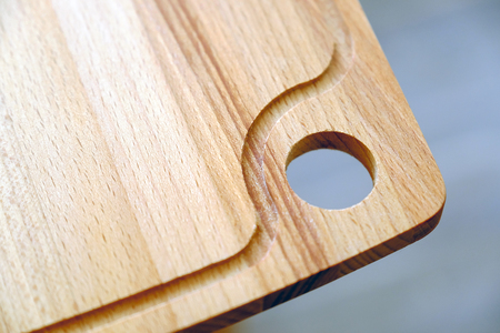 Cutting board. Hanging hole in the kitchen after use. Stock Photo