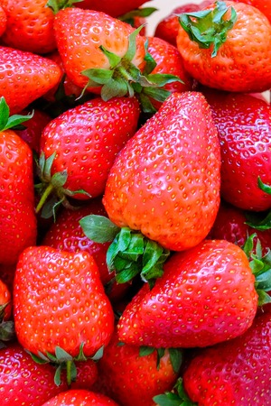 Ripe, juicy, surprisingly tasty strawberry on the table