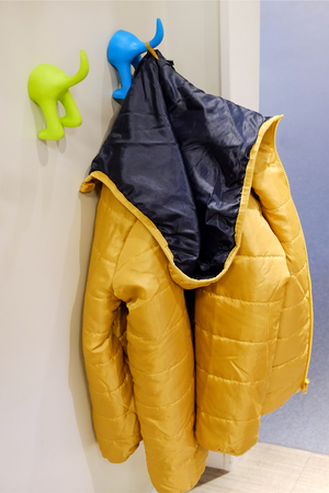 Childrens outerwear on the hanger. Windbreakers, jackets for walks in cold weather.