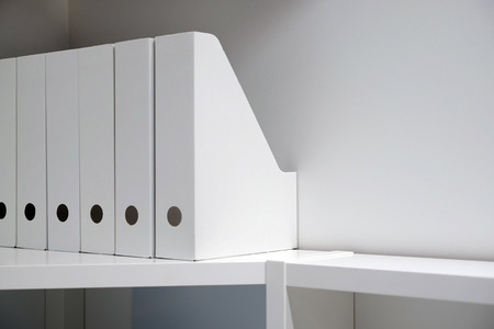 Office folders for documents. A folder with files on the sideboard in a bright modern office, archive and documents.