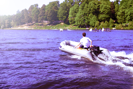 Modern Inflatable Rubber Speed Motor Boat on water. motor inflatable boat.