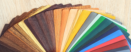 Lamination samples. On a wooden background for lamination of any wooden and plastic products used in construction