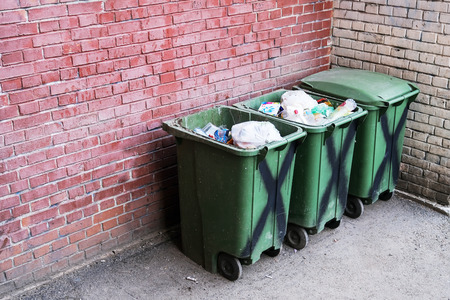 Garbage container. Filled to the brim. Environmental pollution. Ecological pollution. Problem of ecology Stock Photo