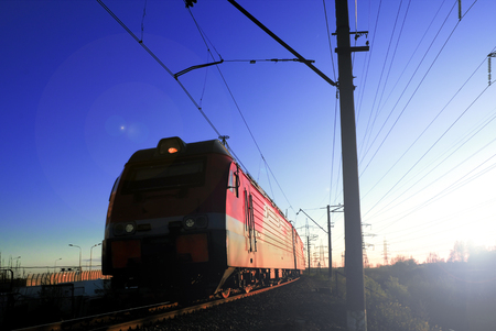 Freight train locomotive carrying with cargo on daylight Banco de Imagens
