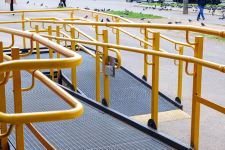 A button to call for help. A ramp for the disabled. The specific path of the ramp with stainless steel handrail. Sign for disabled 스톡 콘텐츠