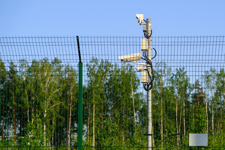 Protected area. Surveillance cameras for surveillance. CCTV footage from our property. Fence