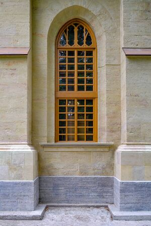 Wooden Windows of the temple in the Gothic style. Temple in the deep forest. Travel in nature, adventure Reklamní fotografie