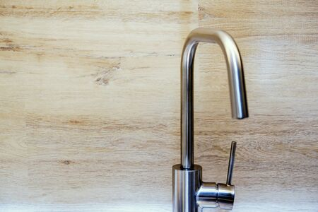 Modern styled kitchen faucet for water. Matte chrome finish