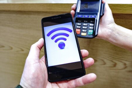 Contactless payment. Online banking. Digital gadget. Credit card. Pay by phone