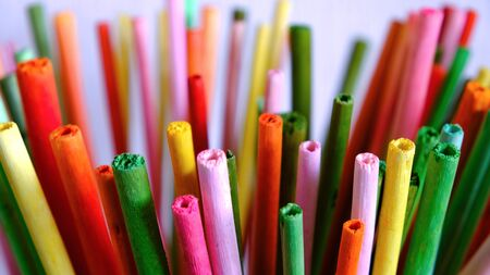 Artistically blurred distance colored sticks background on light background. Business creativity. Blurred background. Selective focus.