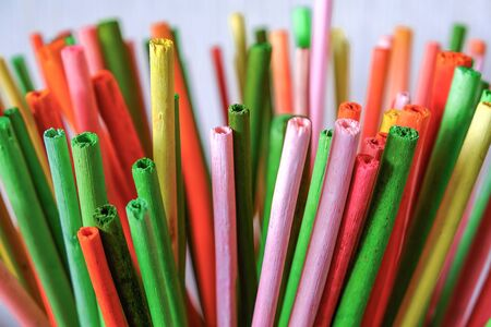 Artistic design. Colorful colored sticks on light background. Business creativity. White background