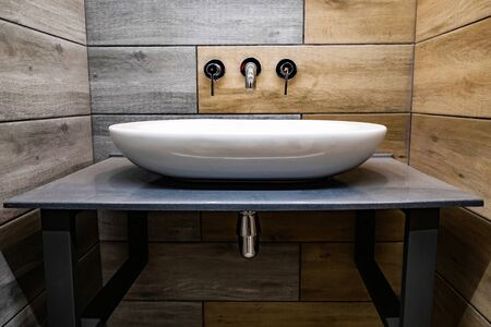 Classic modern white washbasins with chrome water tap and soap dish