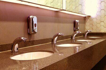 Classic modern washbasins with chrome touch water tap and soap dish