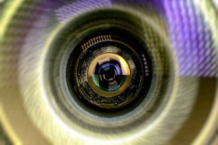 Security camera lens on a blue background for conceptual design. Dark background. Technological concept. Security concept. The facial recognition Program to find the culprits
