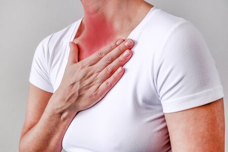 sore throat, shown red, keep handed, isolated on white background Banco de Imagens - 138512213