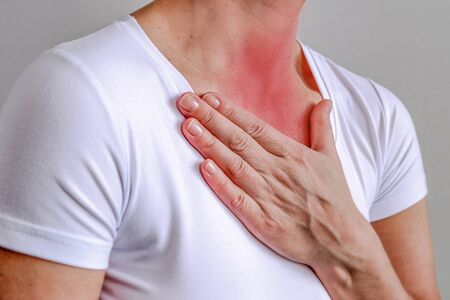 sore throat, shown red, keep handed, isolated on white background Banco de Imagens