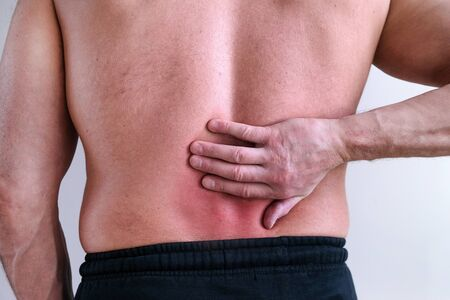 Intervertebral hernia. Sports physical therapy. Rheumatism. The concept of physical trauma. The concept of pain Banco de Imagens