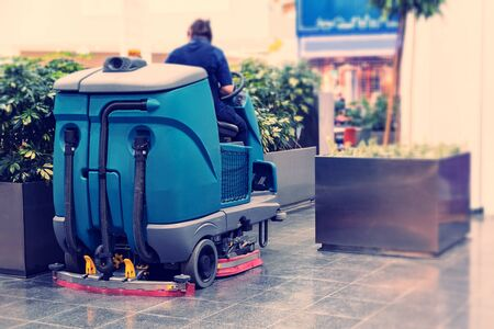 Cleaning machine for sanitation in the supermarket. Behind the wheel cleaner