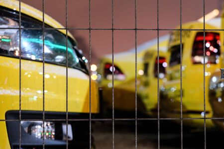 Taxi rank. Yellow cars with black checkers. Artistic style of photo frames Banco de Imagens