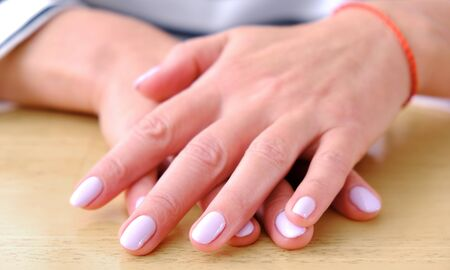 Hands manicure. Glamorous girl. Hand care. Female model. Healthy lifestyle background. Isolated background