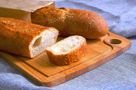 Fresh warm baguette with a crispy crust. Sliced for Breakfast. For the morning sandwich
