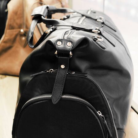 Road leather bag. Luxury travel. Casual style, beauty accessories. Beauty model. Retro style