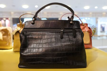 Womens shoulder bag made of crocodile skin