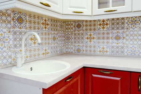 Classic modern kitchen interior. Sink for dishes and water tap in white style Stock Photo