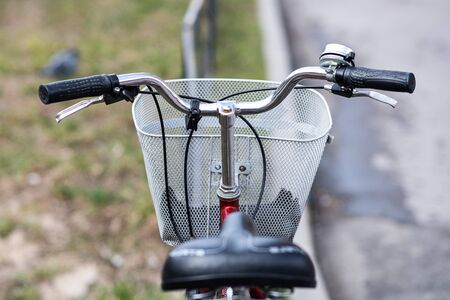Quarantine period delivery of products by Bicycle courier. A basket for transporting food from a supermarket is attached to the handlebar of the Bicycle