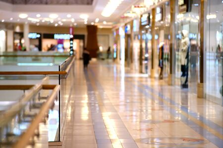 Background, blur, out of focus, bokeh. Soft light in the shopping halls of the shopping and entertainment center. Empty, there are no visitors. The lack of trade is linked to the pandemic