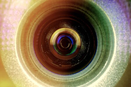 Abstract background. Conceptual design of the photographer's business card.Camera lens in the background for conceptual design. Dark background. Technological concept. Business concept