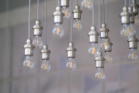 Led energy-saving light bulb. The concept of modern economical lighting. Stock Photo