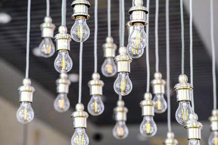 Led energy-saving light bulb. The concept of modern economical lighting. Фото со стока