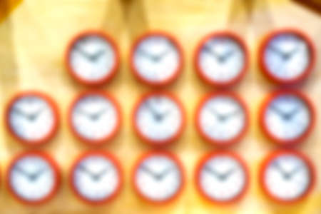 Blur the background. The clock on the wall is arranged in a row.