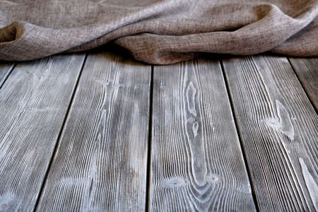 Rustic table made of planks. Canvas fabric. Background for design solutions Foto de archivo