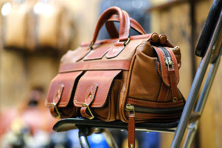 Travel backpack made of genuine leather. The concept of stylish leather products. Bags, purses, and belts