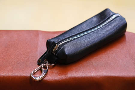 The housekeeper is made of genuine leather. The concept of stylish leather products. Bags, purses, and belts.