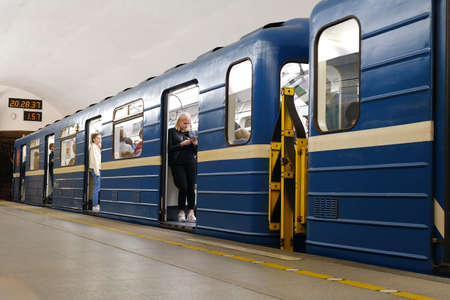 The metro train stopped at the station. The doors of the car are open and passengers are waiting for departure. Saint-Petersburg. Russia. October 17 2020