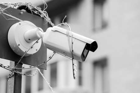 Black-and-white photo, close-up security camera. Criminal facial recognition software. Security concept. Security concept. Banque d'images