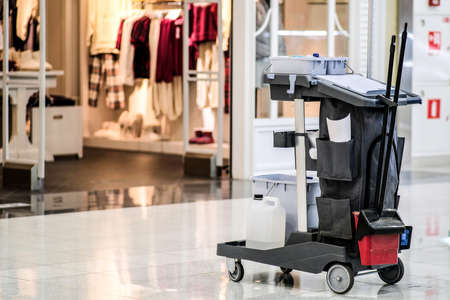 Universal set for wet cleaning of shopping center premises. Modern cleaning company, cleaning kit on a trolley with wheels, excellent design for any purpose. Concept of a commercial cleaning company